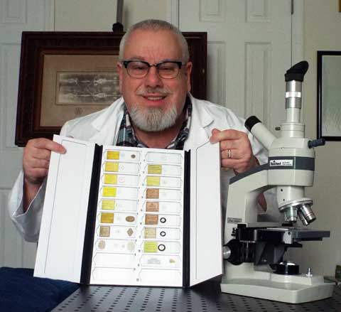 Frank DeFreitas displays part of his microscopic scripture collection in 2019.